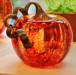 beautiful hand-blown glass pumpkin with twirly stem made at the Sandwich Glass Museum